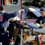 School mass shooting victim in a stretcher with paramedics