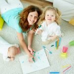 A home babysitter drawing on a paper with kids
