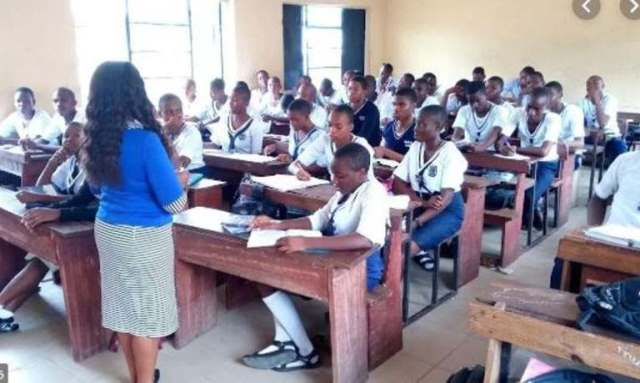 A teacher in a classroom in a Nigerian secondary school