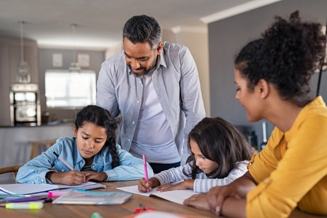 At-homeschooling parents with two kids learning