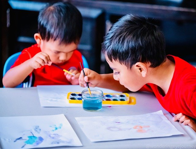 Two homeschool pupils involved in hands-on arts