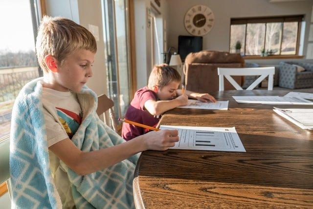 Two kids learning in an informal homeschool setting