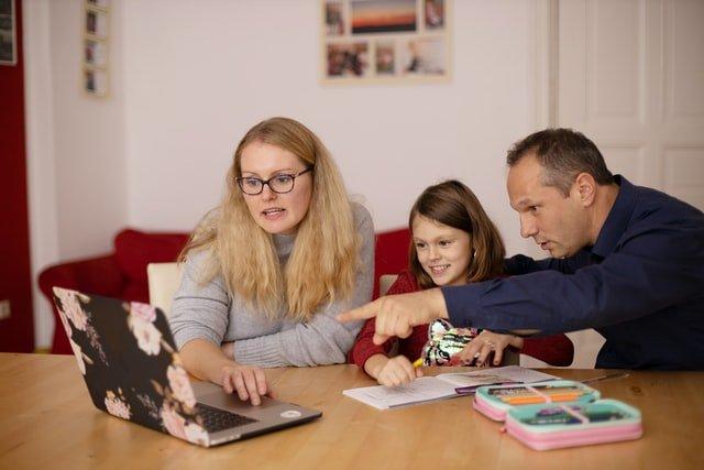 Two teachers providing enjoying guidance to a homeschooler