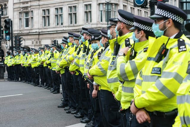 The London Metropolitan Police on duty waiting for dispersal order